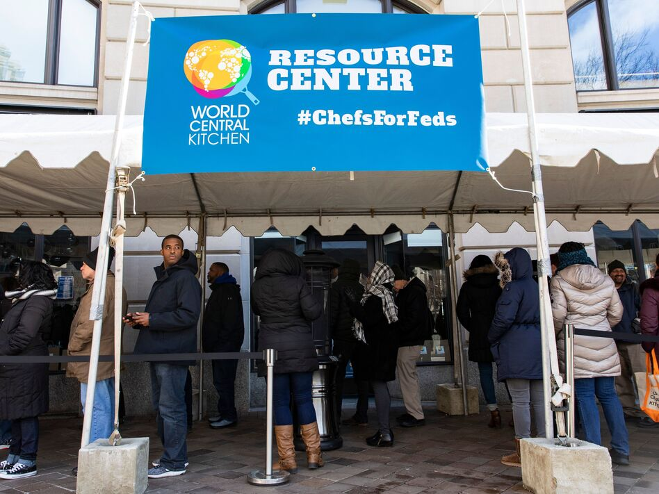 Federal employees wait in line at World Central Kitchen, a food bank and food distribution center established by celebrity chef José Andrés. The federal government is back open, but it could be several days before workers receive missed paychecks. (Alex Edelman/AFP/Getty Images)