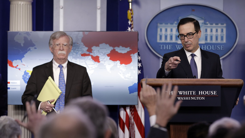 Treasury Secretary Steven Mnuchin (right) and National Security Adviser John Bolton announce sanctions against Venezuela at the White House Monday. (Evan Vucci/AP)