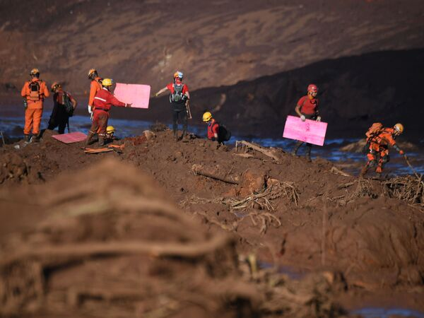 Rescuers search for vicitms near the town of Brumadinho, in the state of Minas Gerias, southeastern Brazil, three days after the collapse of a dam at an iron-ore mine belonging to Brazil's giant mining company Vale.