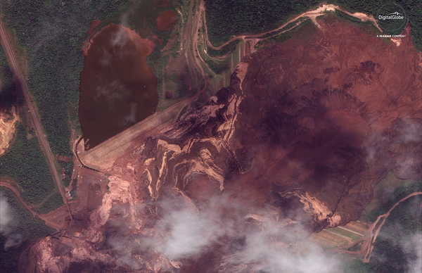 The Vale mining company says that Dam I of the Córrego de Feijão mine was more than 280 feet high and 2,360 feet wide, holding a volume of 11.7 million cubic meters. The ruined mine near Brumadinho, Brazil, is seen here in a satellite photo from Jan. 26.