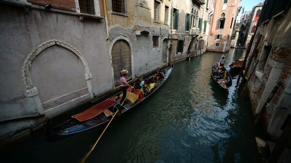 A gondola sails in a Venice canal in September.