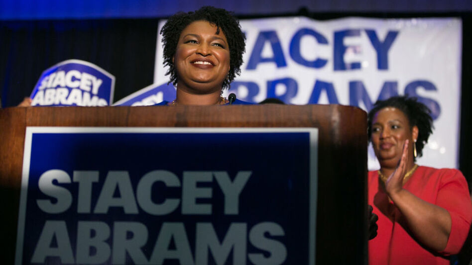 Then-Georgia Democratic gubernatorial candidate Stacey Abrams takes the stage to declare victory in the primary during an election night event in May 2018. (Jessica McGowan/Getty Images)