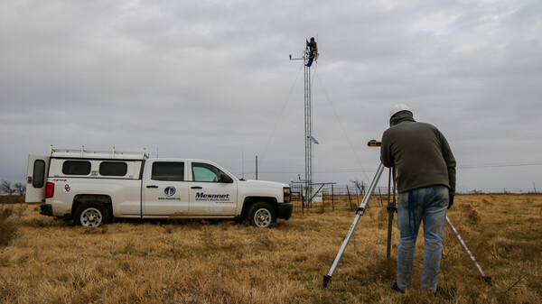 Meteorological Electronics Technicians Christopher Bieschke and Kirk Wilson replace a wind sensor atop a 30-foot tower at an Oklahoma Mesonet station near Shawnee, Okla.