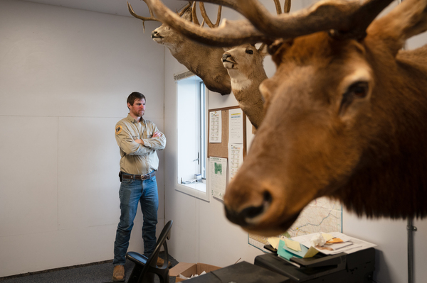 Wesley Sarmento, the bear biologist in Bradley's region, stands in the Fish and Wildlife Service office in Conrad, Mont.