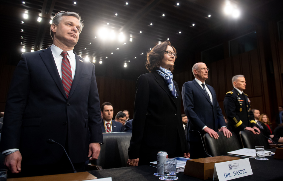 FBI Director Christopher Wray (from left), CIA Director Gina Haspel, Director of National Intelligence Dan Coats and Lt. Gen. Robert Ashley, director of the Defense Intelligence Agency, arrive to testify before the Senate intelligence committee on Capitol Hill on Tuesday. (Saul Loeb/AFP/Getty Images)