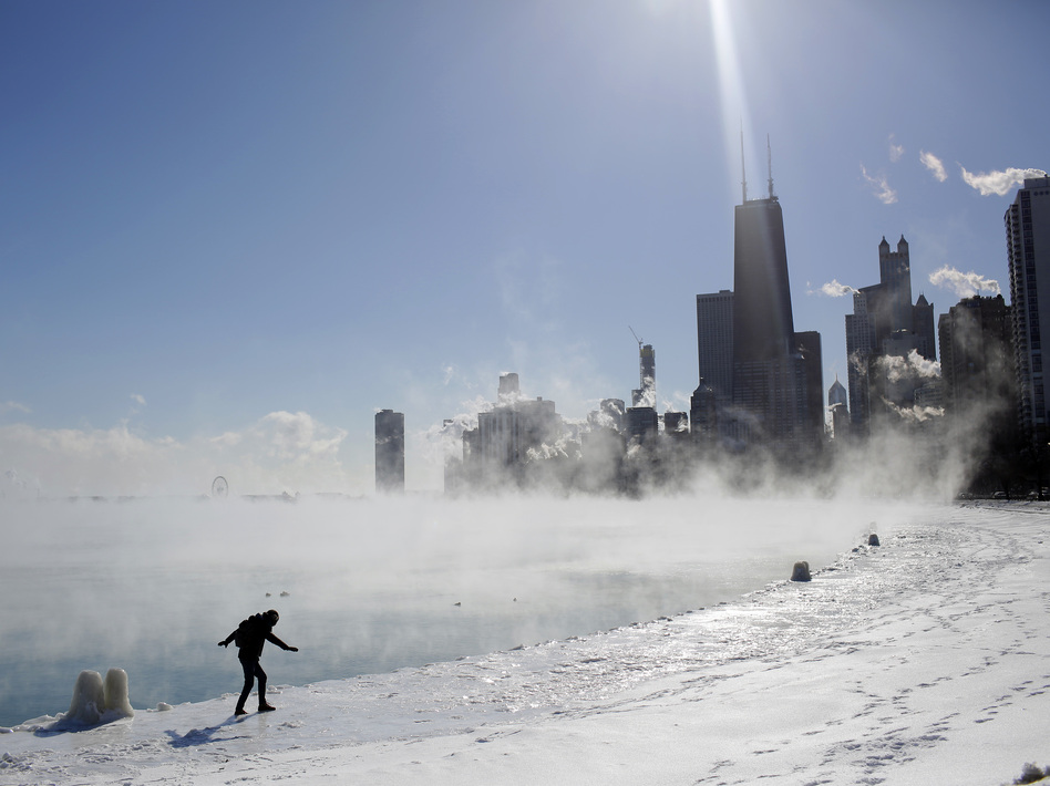 Frigid temperatures arrived in the Upper Midwest with a polar vortex. In Chicago on Wednesday, Marius Radoi walked along a freezing Lake Michigan. (Joshua Lott/AFP/Getty Images)