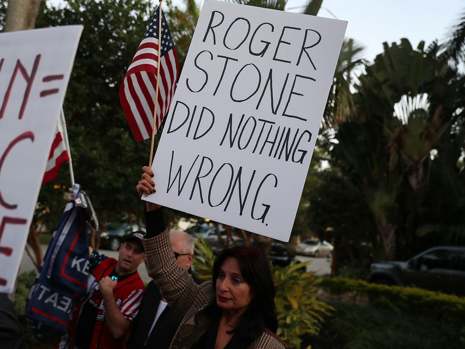 Cindy Falco di Corrado joins with others to show their support for Roger Stone, a longtime adviser to President Trump. A number of Republicans have raised concerns about the way Stone was arrested at his home on Jan. 25. (Joe Raedle/Getty Images)