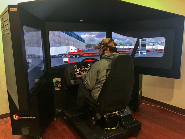 John Bounds sits behind the wheel of a driving simulator.