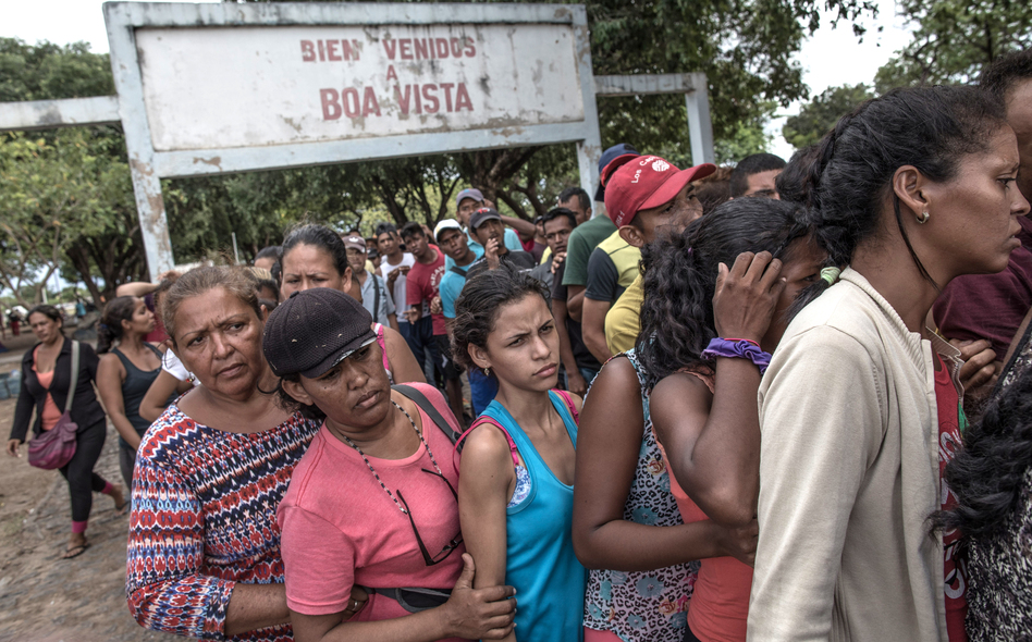 Venezuelans wait in line for food in northern Brazil in February 2018. The migrants often say the main reasons they've fled are to get food and health care. (Andre Coelho/Bloomberg via Getty Images)