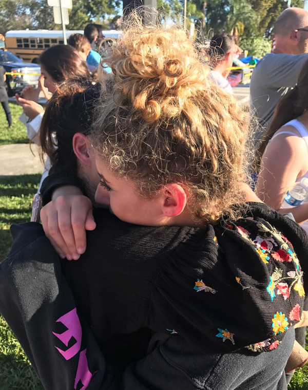 Following last year's mass shooting at Marjory Stoneman Douglas High School, student Maya Altman and her mother, Robyn Altman, embrace.