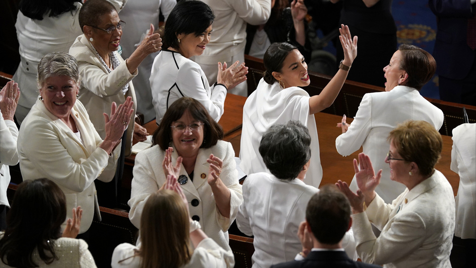 Democratic women lawmakers, dressed in white as a tribute to early-20th-century suffragettes, applaud at President Trump's State of the Union address. (Carolyn Kaster/AP)