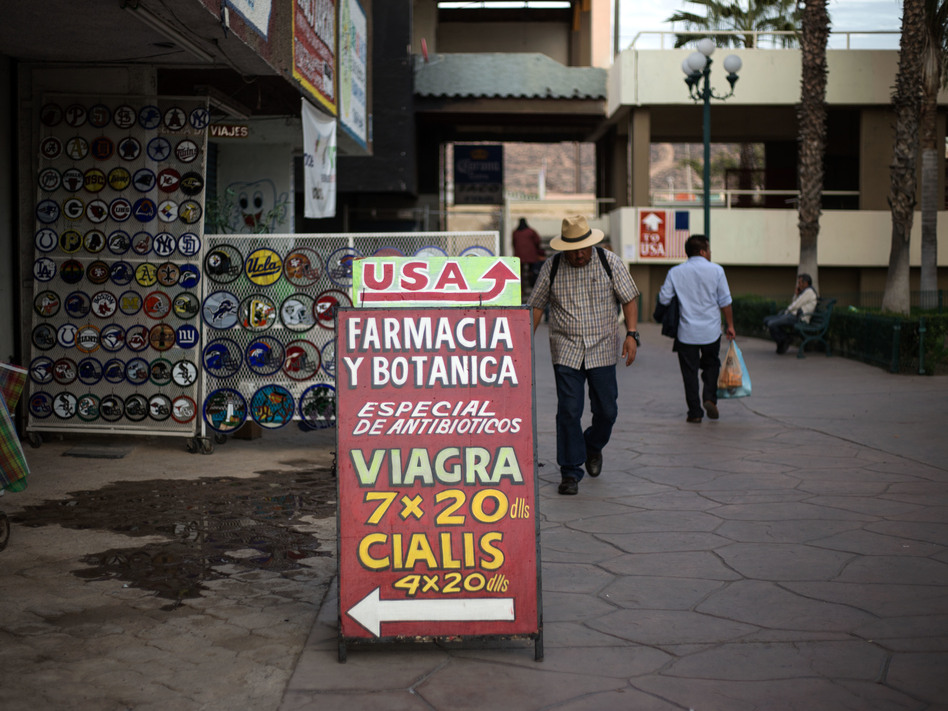 In Mexican border towns, big discount drugstores, as well as small pharmacies like this one in Tijuana, market their less expensive medicines to American tourists. (Guillermo Arias/Bloomberg via Getty Images)