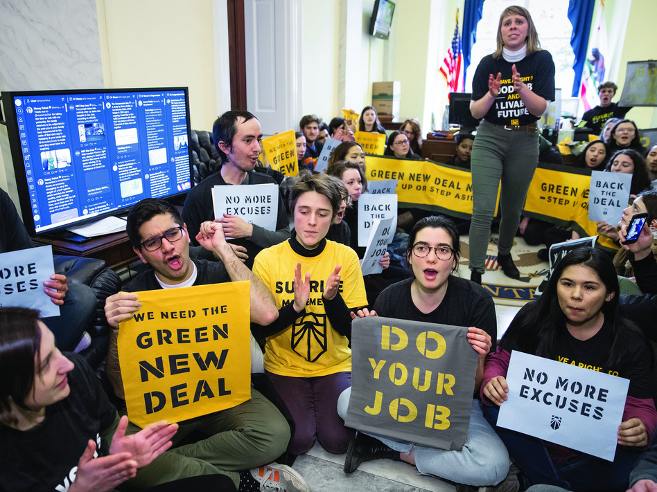 Environmental activists occupy the office of House Democratic Leader Nancy Pelosi this past December. They plan more sit-ins to push for support of a sweeping resolution to address climate change. (J. Scott Applewhite/AP)