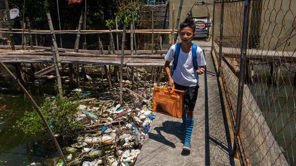 Around the globe, people are searching for ways to reduce plastic waste. Above: Dampalit, a fishing community in Manila Bay, can