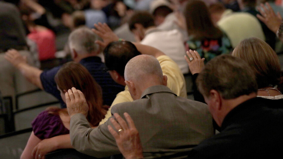 People pray during the Southern Baptist Convention annual meeting in Phoenix in 2017. (Matt York/AP)