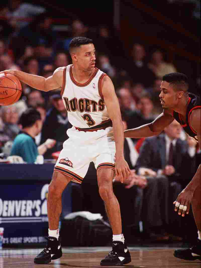 Mahmoud Abdul-Rauf of the Denver Nuggets shields the ball against the Portland Trailblazers in January 18, 1994.