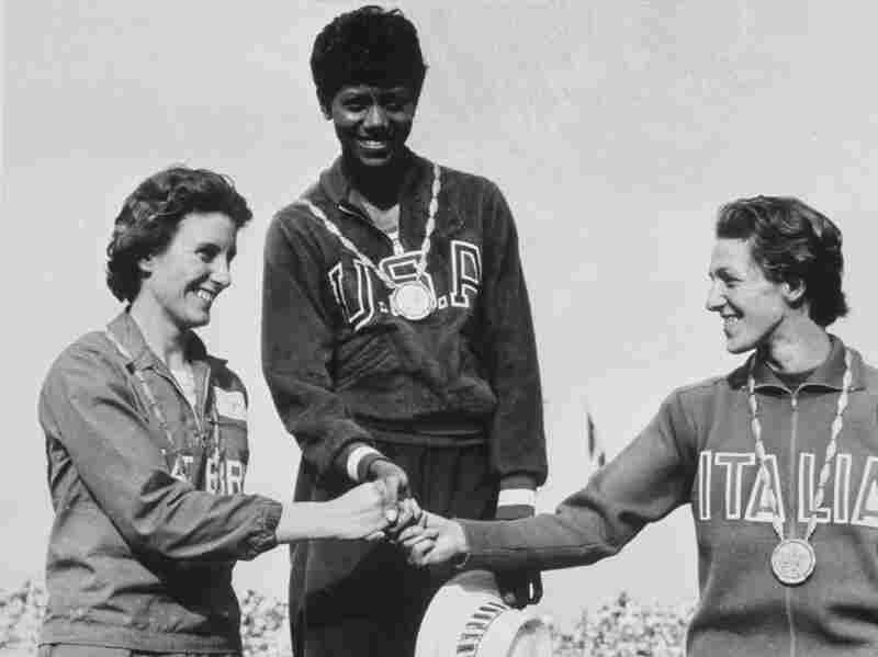 Wilma Rudolph (middle) standing on the awards stand with competitors Dorothy Hyman (left) and G. Leone (right) after winning the gold medal in the 200m sprint at the Summer Olympics in Rome, Italy. She was the first ever woman to run the 200m event in less than 23 seconds.