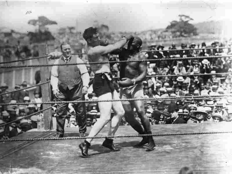 Jack Johnson (right) world heavyweight champion since 1908, loses his title to fellow American fighter Jess Willard (left) in Havana, Cuba, in 1915.