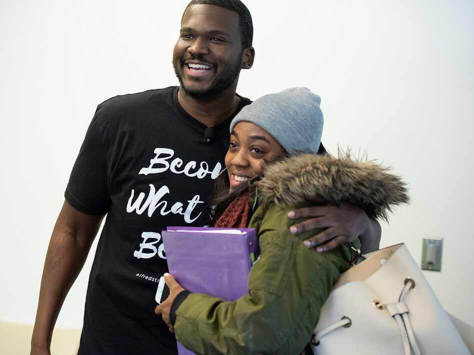 Marc Lavarin, an assistant minister at Alfred Street Baptist Church, hugs Howard University student Mya Thompson after she learns the church's members have paid the $2,500 she owed the university. (Charles Matthews/Alfred Street Baptist Church)