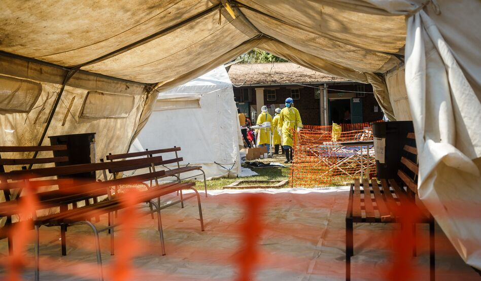 Health staff prepare a cholera treatment tent in September 2018. The country's health system lacks the capacity to contain diseases like cholera. (Jekesai Njikizana/AFP/Getty Images)