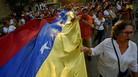 Venezuelans protest against the government of Nicolás Maduro in Cúcuta, Colombia, near the border with Venezuela, on Tuesday.
