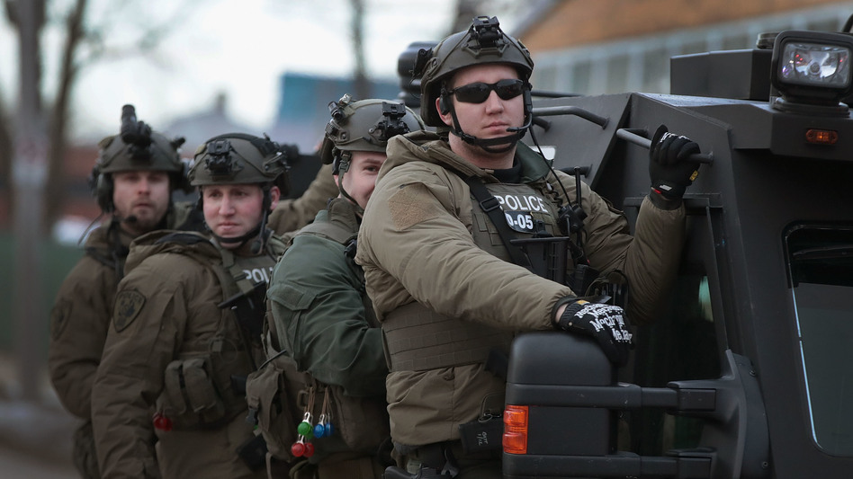 Police secure the area following a mass shooting at the Henry Pratt Co. in Aurora, Ill., on Friday. A gunman killed five people and wounded five police officers before being fatally shot by police. (Scott Olson/Getty Images)