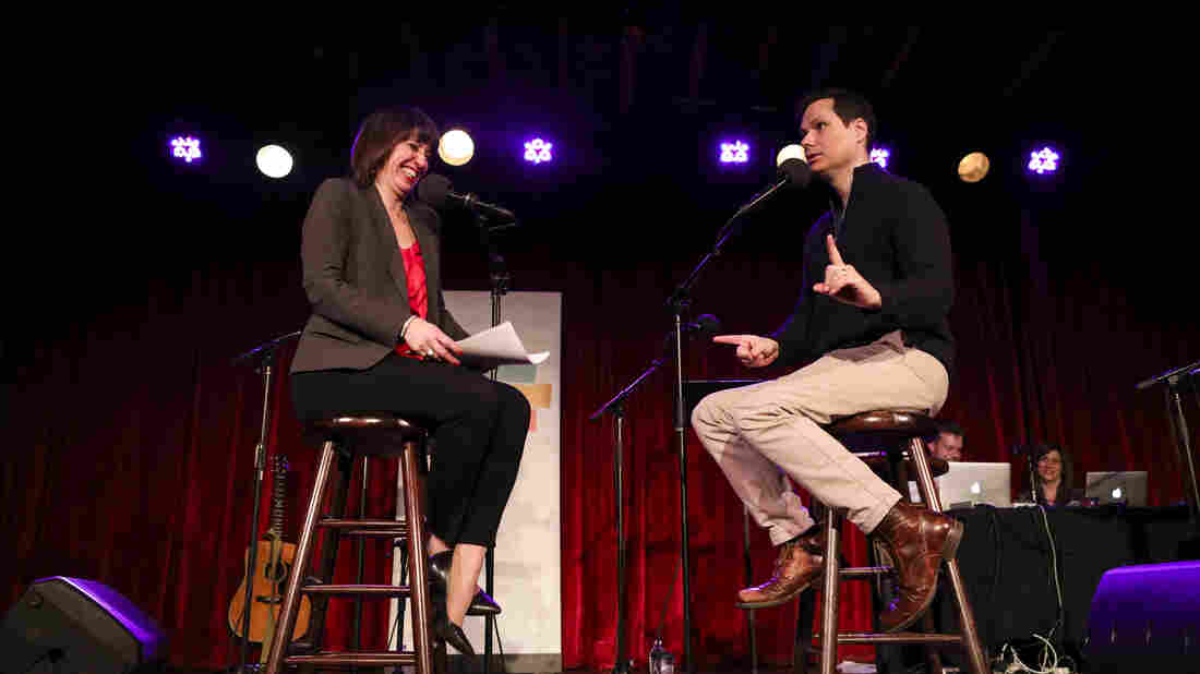 Ophira Eisenberg interviews comedian Michael Ian Black on Ask Me Another at the Bell House in Brooklyn, New York