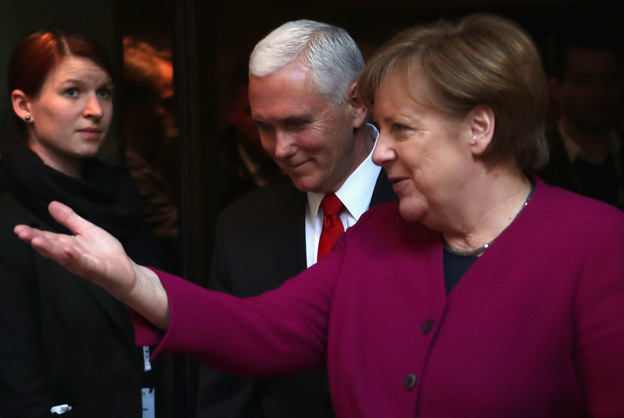 German Chancellor Angela Merkel and U.S. Vice President Pence talk at the Munich Security Conference on Saturday.