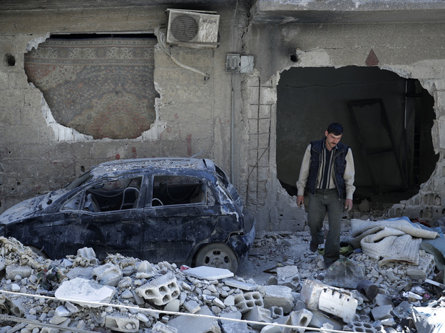 A man walks amid rubble in the Syrian town of Douma in April 2018. A report out Sunday confirmed that a chemical attack early that month was one of hundreds since the start of the Syrian civil war.