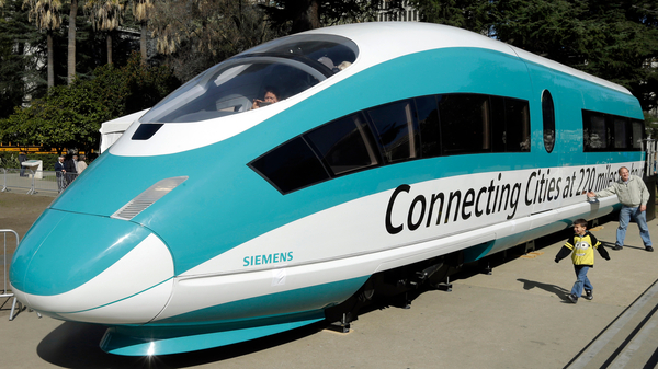 A full-scale mock-up of a high-speed train is on display at the Capitol in Sacramento, Calif., in 2015. The Trump administration is planning to cancel a $929 million federal grant for the project.