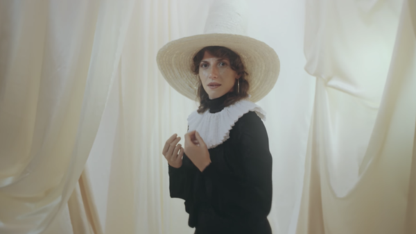 "Aldous Harding in a scene from her video for the song ""The Barrel."""