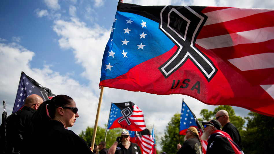 The National Socialist Movement, a neo-Nazi group that has been designated a hate group by the Southern Poverty Law Center, held a rally in Newnan, Ga., in April 2018. (David Goldman/AP)