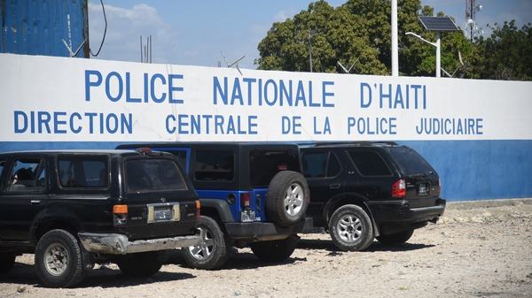 Five Americans and several other men were arrested after police discovered they were carrying a number of automatic rifles and pistols in Port-au-Prince. The men are being held at this National Police compound.