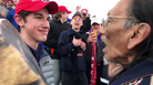 The family of Nicholas Sandmann, 16, is suing <em>The Washington Post,</em> accusing the newspaper of targeting the Covington Catholic High School student for political purposes. Sandmann is seen here along with Native American activist Nathan Phillips on Jan. 18.