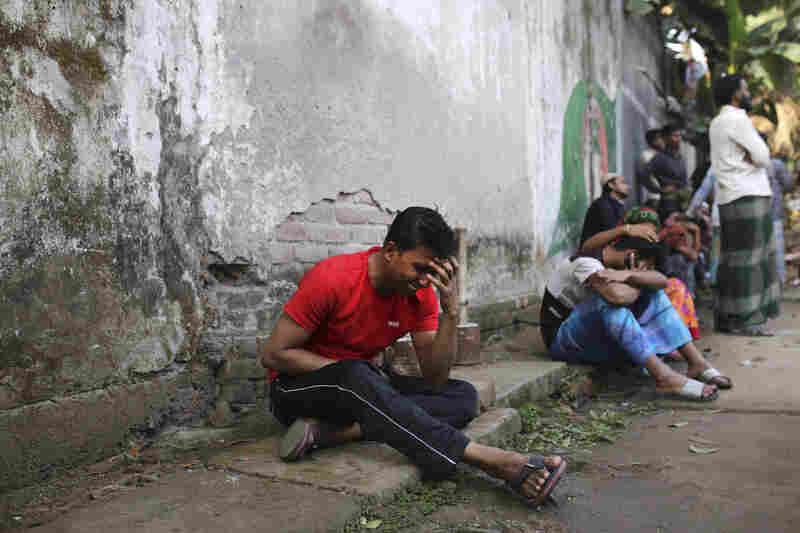 An unidentified Bangladeshi man cries by the site of a fire that broke out late Wednesday in closely set buildings in the capital.