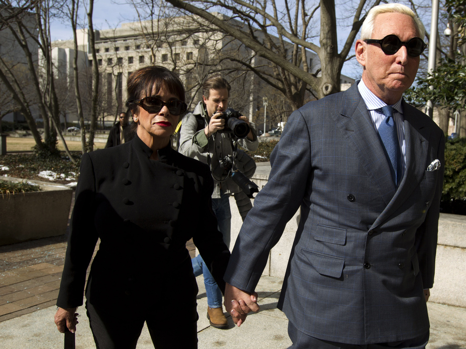 Roger Stone, accompanied by his wife, Nydia, arrives at federal court in Washington, D.C., on Thursday. The former campaign adviser for President Trump has been forbidden to speak publicly about his case. (Jose Luis Magana/AP)