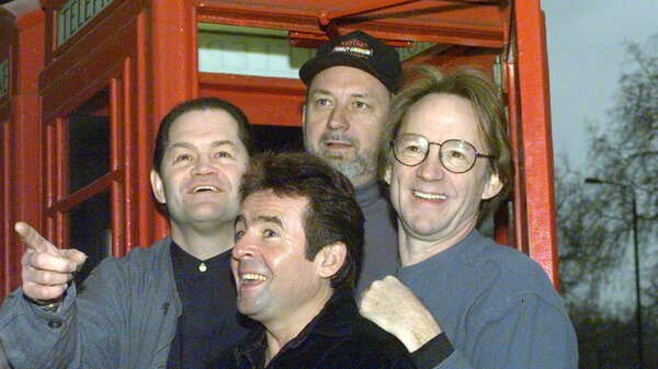 The Monkees, (l-r: Mickey Dolenz, Davy Jones, Mike Nesmith and Peter Tork) pose in front of a London telephone booth in 1997.