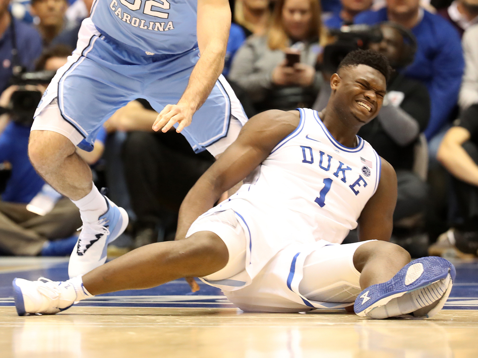 ae063874a6ad Duke s Zion Williamson reacts after falling as his shoe breaks in the game  against the North