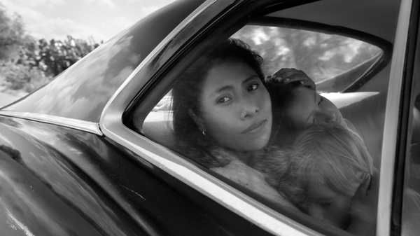 Yalitza Aparicio as Cleo, Marco Graf as Pepe, and Daniela Demesa as Sofi in Roma, written and directed by Alfonso Cuarón.