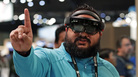 Raman Ghuman demonstrates a HoloLens device at Microsoft's annual conference for software developers on May 7, 2018, in Seattle. Microsoft workers are protesting the use of the augmented reality technology in a U.S. Amy contract.