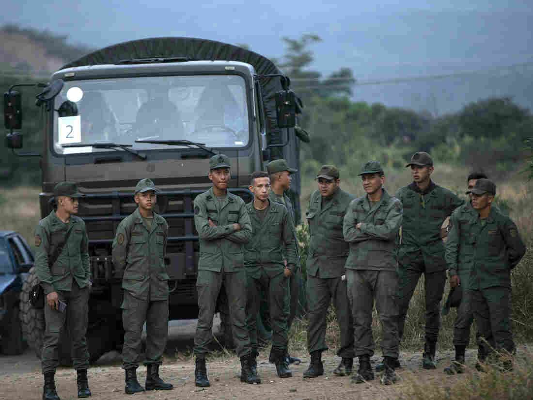Standoff at Venezuela border leaves a dozen injured, at least one dead