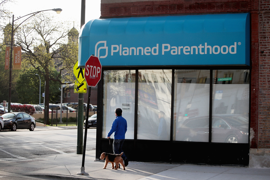 A person walks by a Planned Parenthood clinic on May 18, 2018 in Chicago. Under the new rule, posted Friday by the federal Department of Health and Human Services Office of Population Affairs, any organization that provides or refers patients for abortions is ineligible for Title X funding to cover STD prevention, cancer screenings and contraception. (Scott Olson/Getty Images)