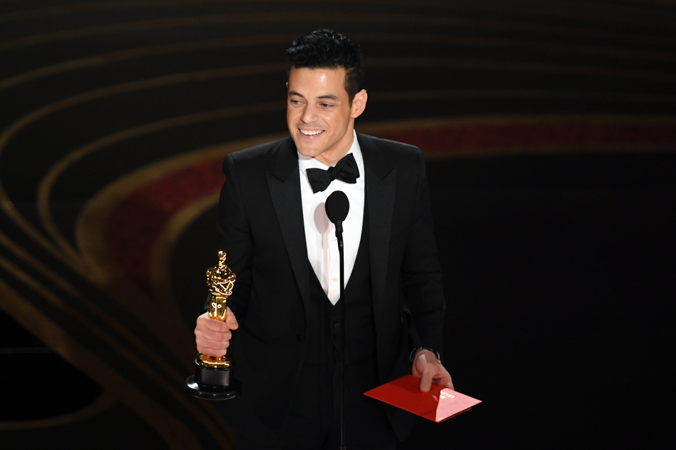 Rami Malek accepts the Academy Award for actor in a leading role for his performance in <em>Bohemian Rhapsody.</em> (Kevin Winter/Getty Images)