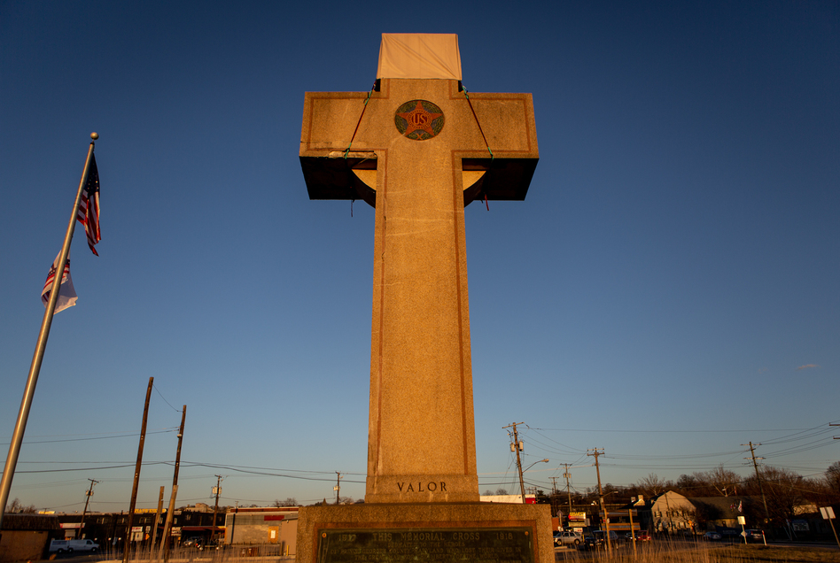 A World War I memorial cross sits in Bladensburg, Md., just outside Washington, D.C. The federal government asked the Supreme Court to rule in favor of the cross, which critics say is an unconstitutional state religious endorsement. Arguments are scheduled to be heard this week. (Becky Harlan/NPR)