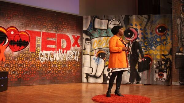 Amy Hunter on the TED stage.