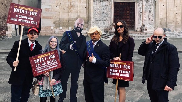 From left to right, an impersonation of Barron Trump in a Make America Great Again hat, Ivanka Trump, a cardboard cutout of Ridolfi when not in costume, Ridolfi in a Donald Trump costume, a Melania Trump look-alike and a man in a Secret Service costume.