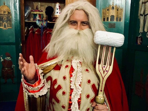 """Sebastiano Ridolfi tries on the costume of Papà del Gnoco, or """"Gnocchi Dad,"""" the Santa-esque figure who's the symbol of the gnocchi-themed pre-Lent celebration in Verona, Italy. Although Ridolfi didn't win the election to be Papà del Gnoco, he was received warmly by the crowd and remains committed to challenging traditions."""