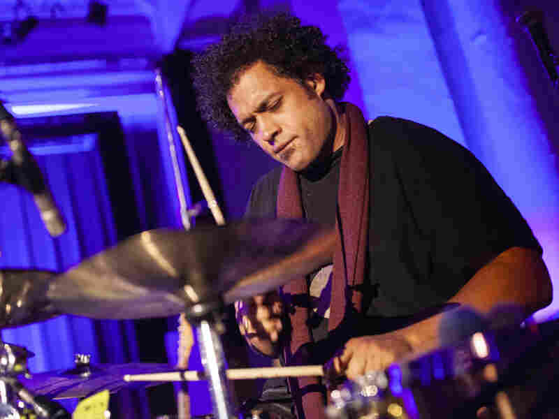 Makaya McCraven accompanies his 10 piece ensemble at Paul Robeson Theatre in the historical South Shore Cultural Center in Chicago, USA