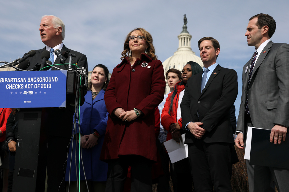 U.S. Rep. Mike Thompson (left), D-Calif., joined by shooting survivor and former Rep. Gabby Giffords of Arizona, holds a news conference about his proposed gun background check legislation, on Capitol Hill on Tuesday. (Jonathan Ernst/Reuters)