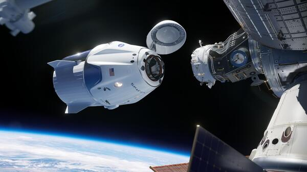 In this illustration, SpaceX's Crew Dragon approaches the International Space Station for docking. The capsule has room to carry seven astronauts.